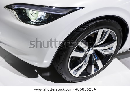 Car headlight and wheel with silver disk of comfortable sport sedan with white bodywork, luxury class vehicle  - stock photo