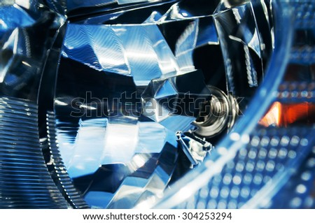 Car headlight extreme close-up with mirror reflection - xenon, led - stock photo