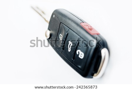 Car Ignition Key with Built-In Remote Locking. Car Keys Isolated on White.