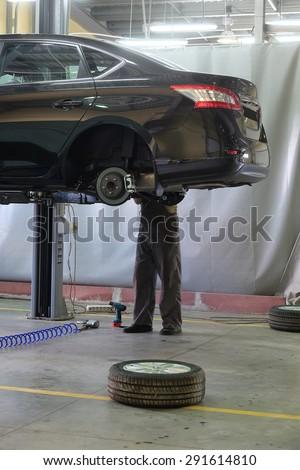 Car in a dealer repair station - stock photo