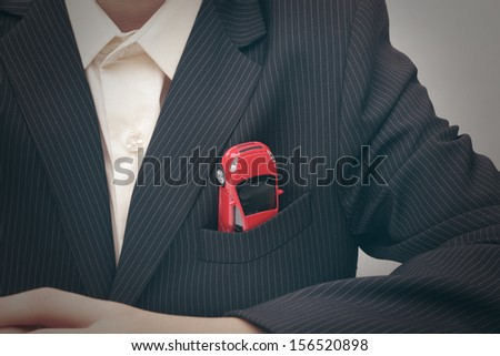 Car in a jacket pocket (concept) - stock photo