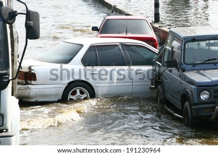 Car in flood water - stock photo