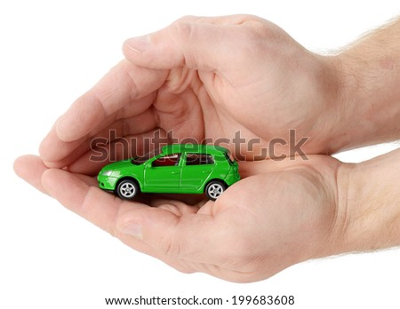car in hands on a white background. Concept of safe driving - stock photo