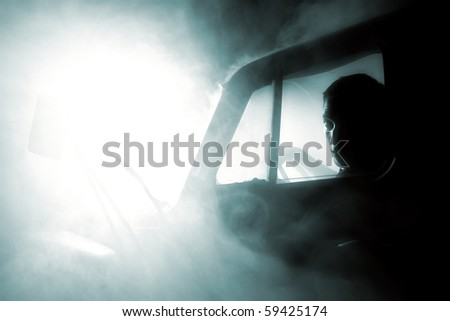 car in smoke