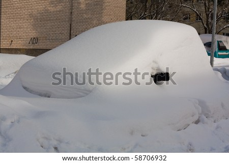 Car in Snowbank in winter