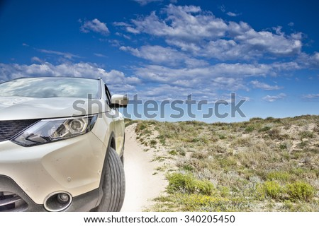 car in the beach dunes - stock photo