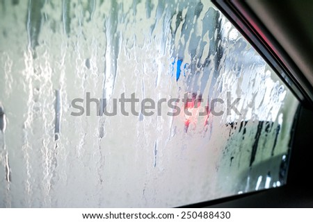 Car inside carwash from interior - stock photo