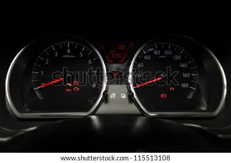 Car instrument panel. Illuminated in the night. - stock photo