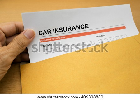 Car Insurance application form on brown envelope  - stock photo