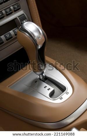 Car interior. Automatic transmission gear shift. - stock photo