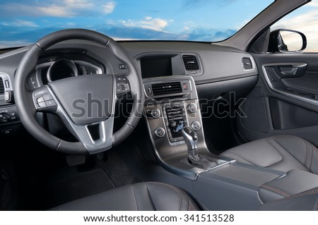 Car interior, blue sky sunset, front window view - stock photo
