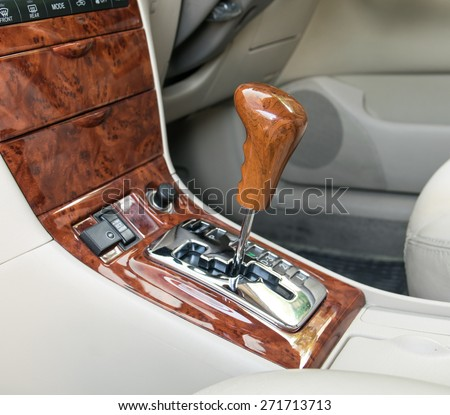 Car interior decorate wood. Automatic transmission gear shift.