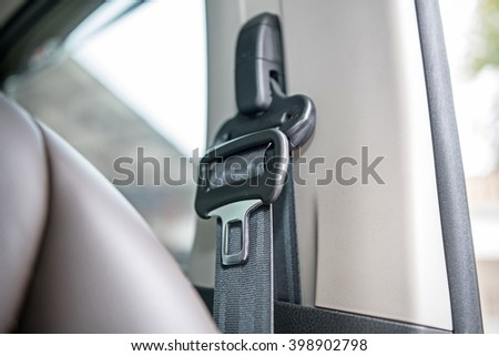 Car interior Detail ; close up of safety belt in a car  - stock photo
