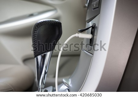 Car interior details of gear and dashboard - stock photo