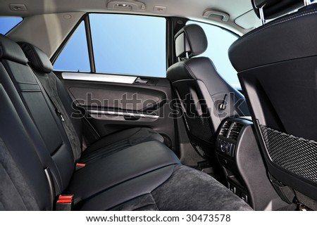 car interior, passenger places with leather and suede sofa - stock photo