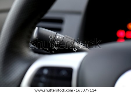 Car interior with light switch