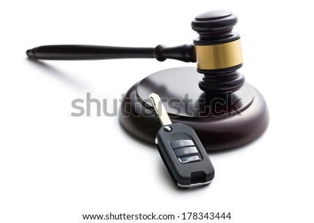 car key and judge gavel on white background - stock photo