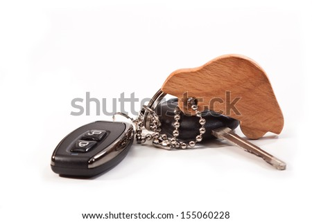 Car key and key chain in the shape of cars on a white background - stock photo