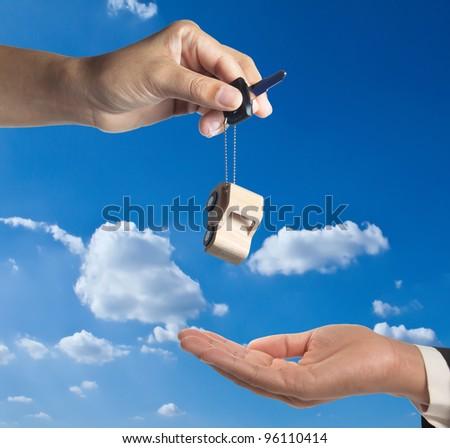 Car-key exchange with blue sky background. - stock photo