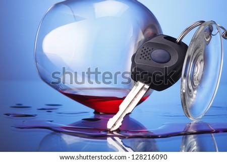 car key hanging at wine glass - stock photo