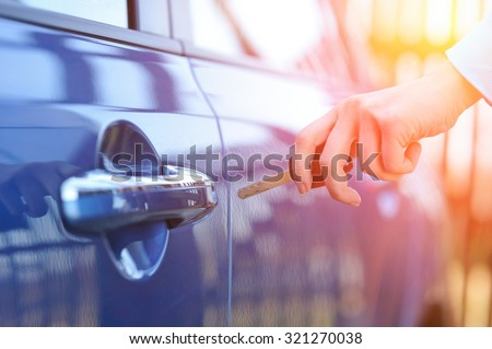 Car key in woman's hand - stock photo