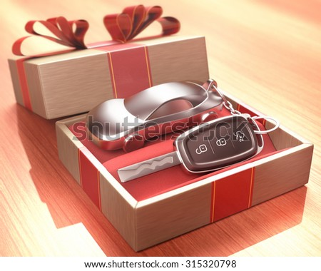 Car key inside a gift box with a red ribbon tied up on the cover. Depth of field with focus on the key button. - stock photo