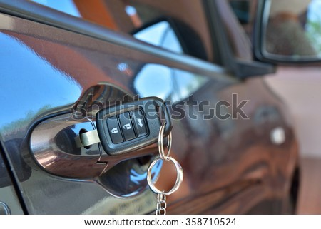 Car key is inserted in a slot car keys. - stock photo