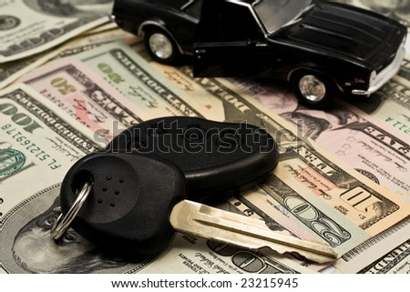 Car key, keychain,  car with an open door on  dollars