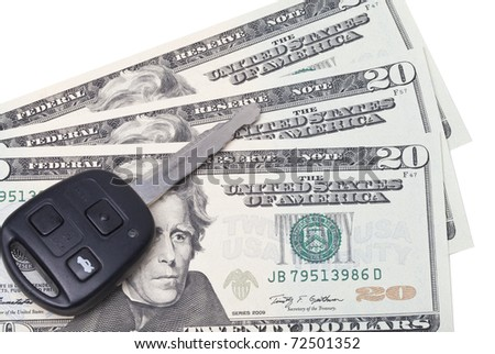 Car key on US dollar bills to represent the cost of motoring - stock photo