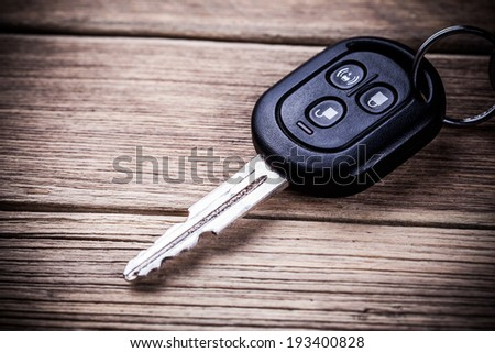 Car key on wooden background - stock photo