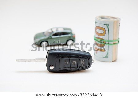 Car key, small car, money.