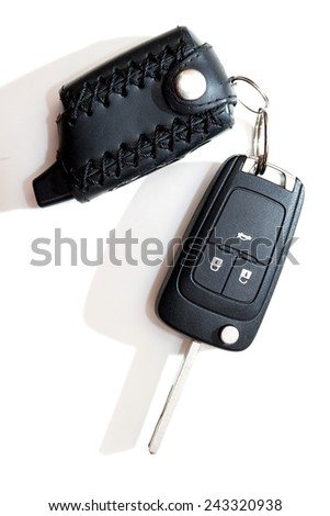 Car key with a keychain alarm. Isolated on white background. transport concept. gift concept - stock photo