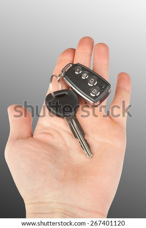 car key with alarm in hand  - stock photo