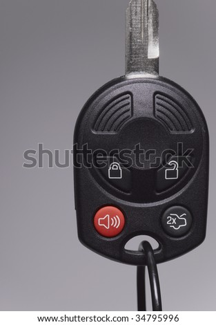 Car key with remote control, close-up - stock photo