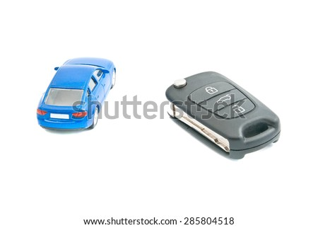 car keys and blue car on white - stock photo