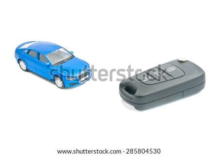 car keys and blue car on white background - stock photo
