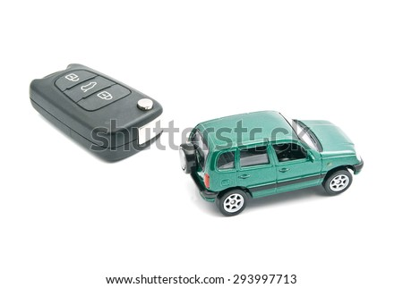 car keys and green car on white