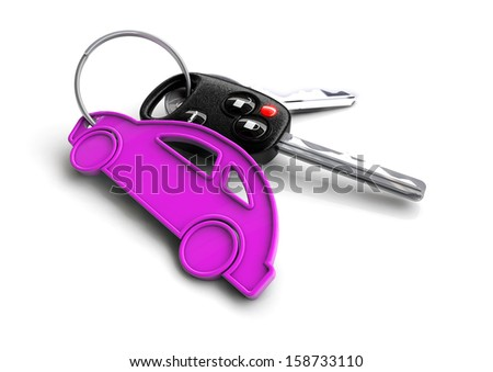 Car keys attached to a pink key ring shaped like a car.  - stock photo