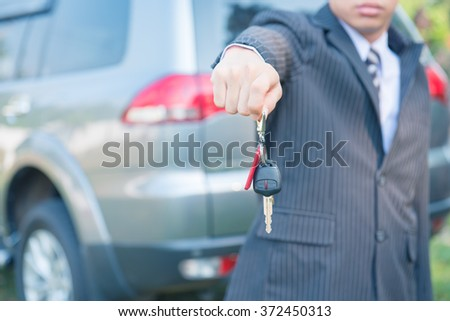 Car Keys,hand showing keys of automobile,Businessman