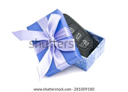 car keys in blue gift box on white - stock photo