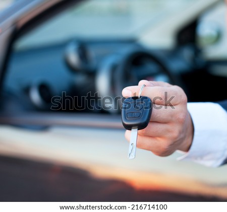 car keys in the hand, rent or buy car - stock photo