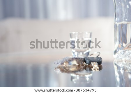 Car keys on the glass table while drinking alcohol / if you drink alcohol don't drive / car keys and alcohol
