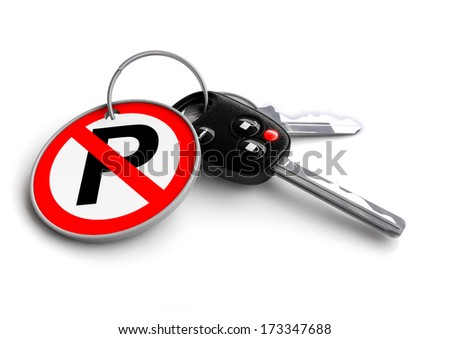 Car keys with keyring showing a no parking road sign. Concept for keeping obeying the rules of the road, driving safely on the road and avoiding potential accidents.