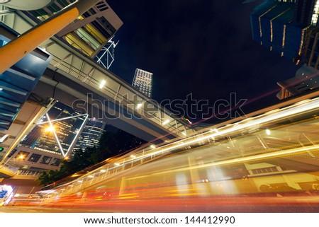 Car light in the modern city night, Hong Kong, Asia. - stock photo