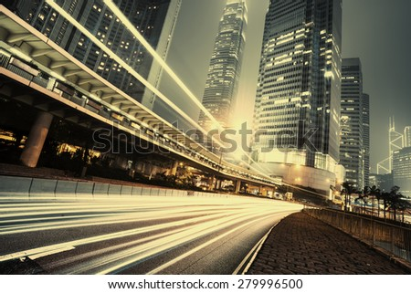 Car light trails and urban landscape in Hong Kong - stock photo
