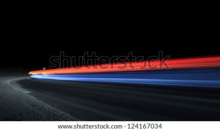 Car light  trails. Art image . Long exposure photo taken in a tunnel - stock photo