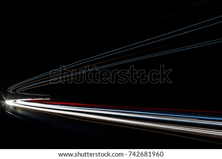 Car light trails. Art image. Long exposure photo taken in a tunnel