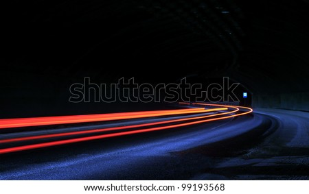Car light trails in the tunnel. Art image . Long exposure photo taken in a tunnel