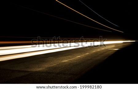 Car light trails in the tunnel.  Art image . Long exposure photo taken in a tunnel below Veliko Tarnovo - stock photo