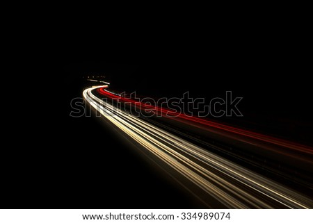 Car light trails, of traffic on the move at street, urban landscape. Art image, photo taken using exposure - stock photo